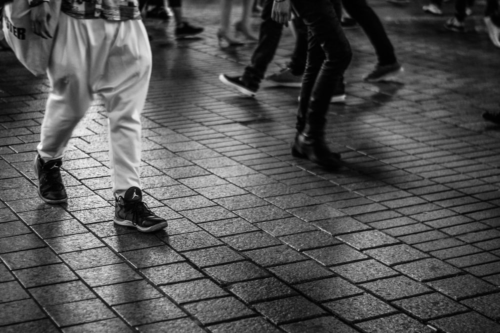 men walking on concrete tiled ground