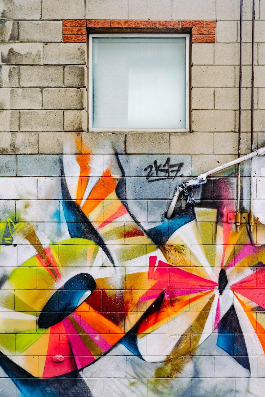 photo of orange, red, and yellow graffiti printed wall