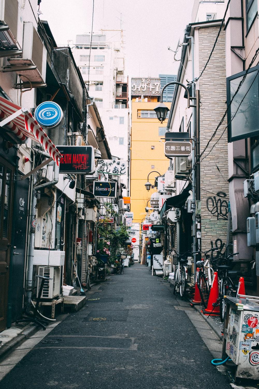 street between gray concrete buildings