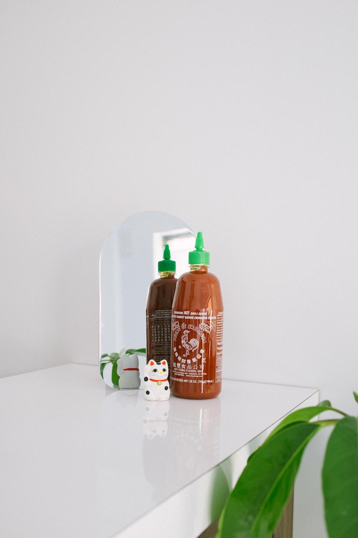 orange labeled plastic squeeze bottle on white surface