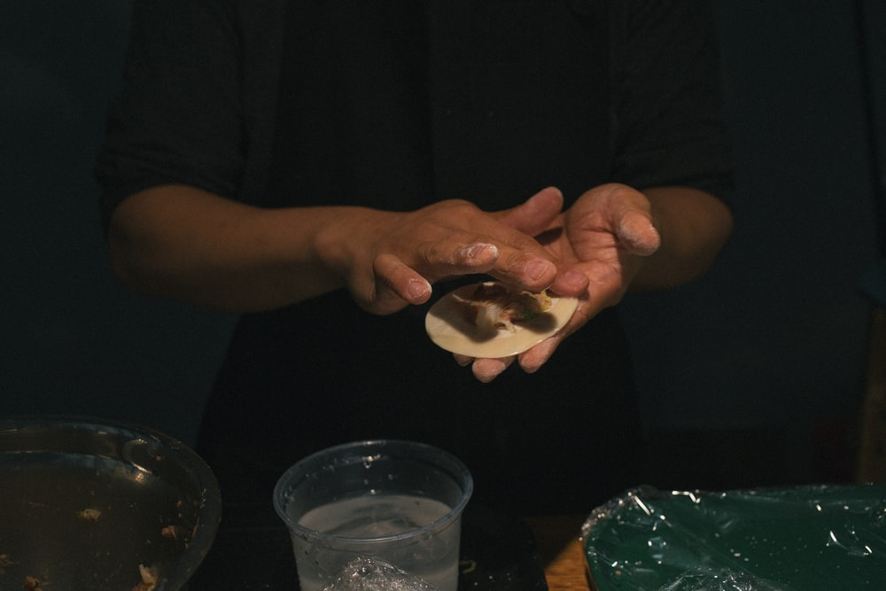 person holding food on palm
