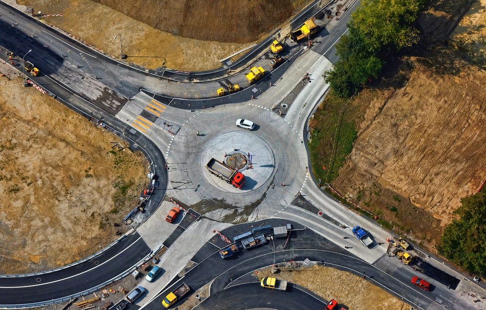 aerial photography of road intersection with vehicles