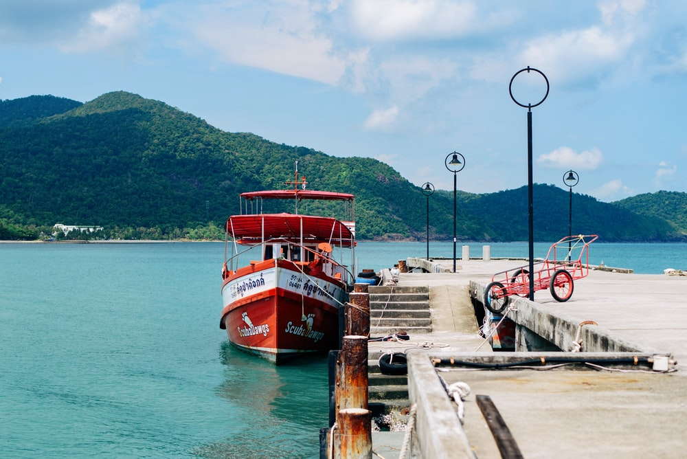 orange boat on dock