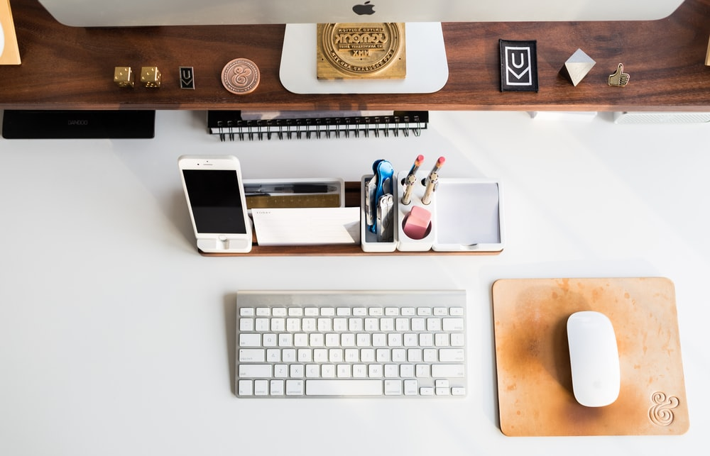 white Apple mouse beside keyboard