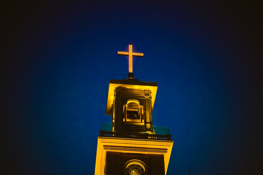 Cross pictures download free images on unsplash a lighted church steeple and cross against the dark blue night sky in beirut voltagebd Image collections