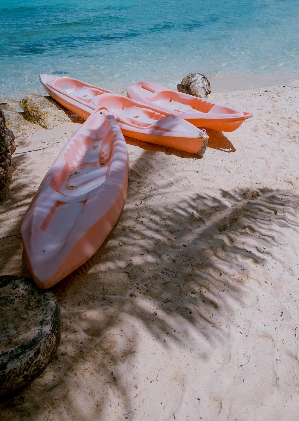 three empty kayaks