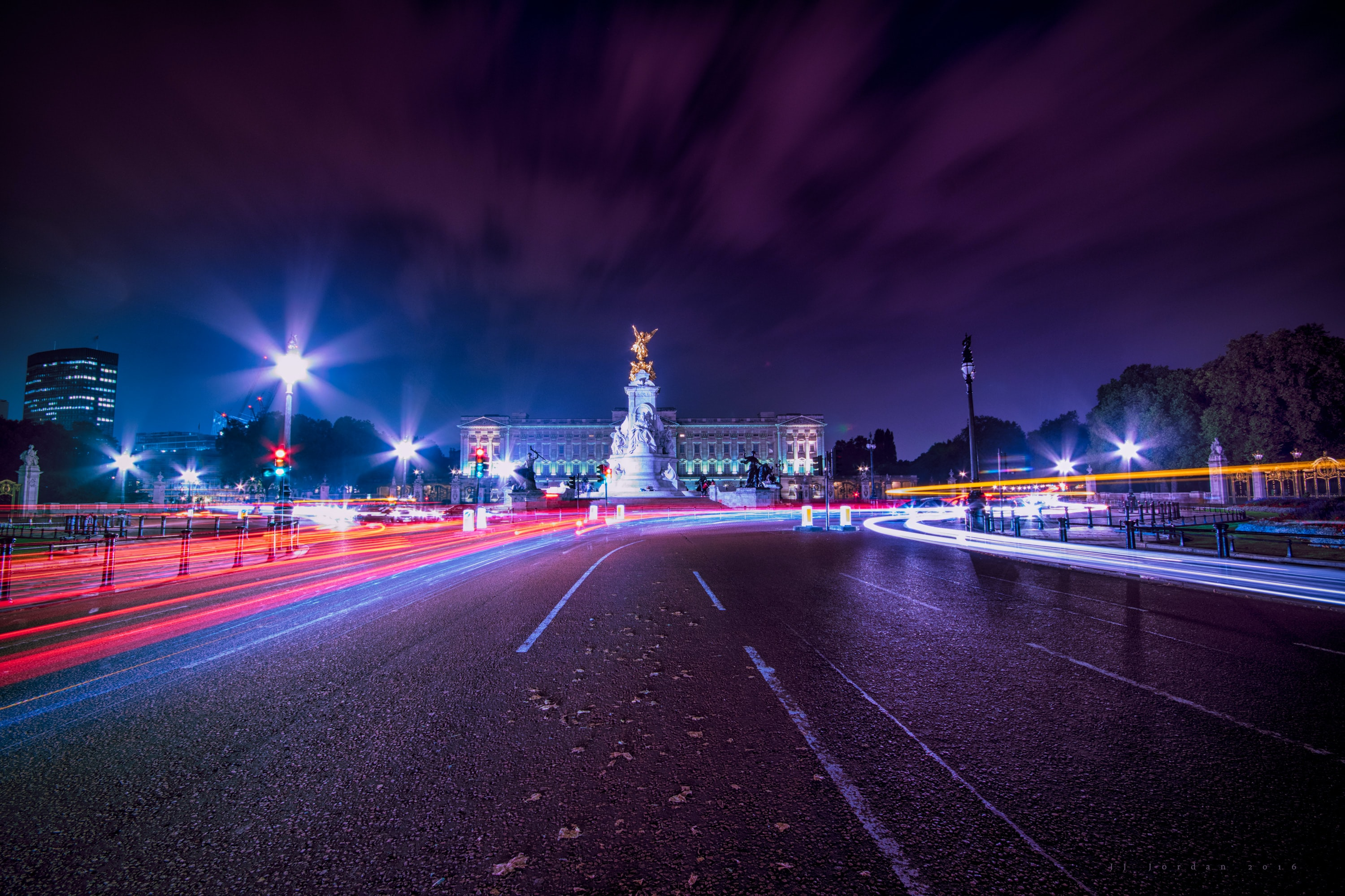 A colorful shot of Pall Mall Street in London, with colorful light trails after dark