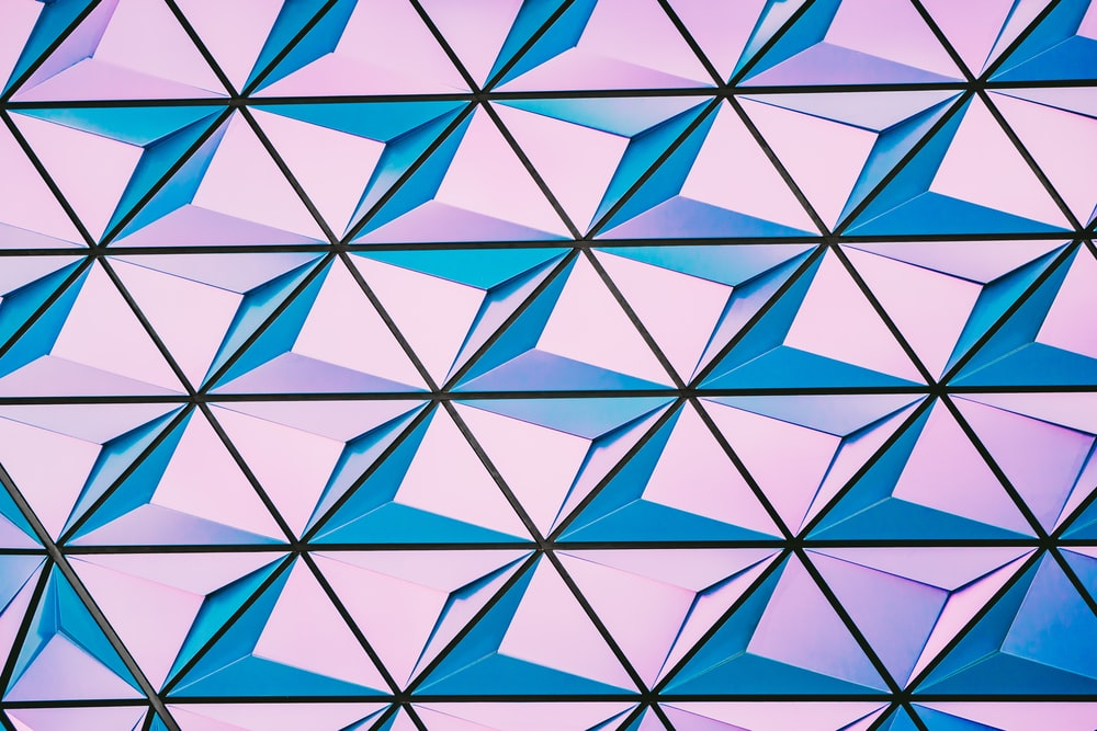 A blue and pink abstract pattern in a facade