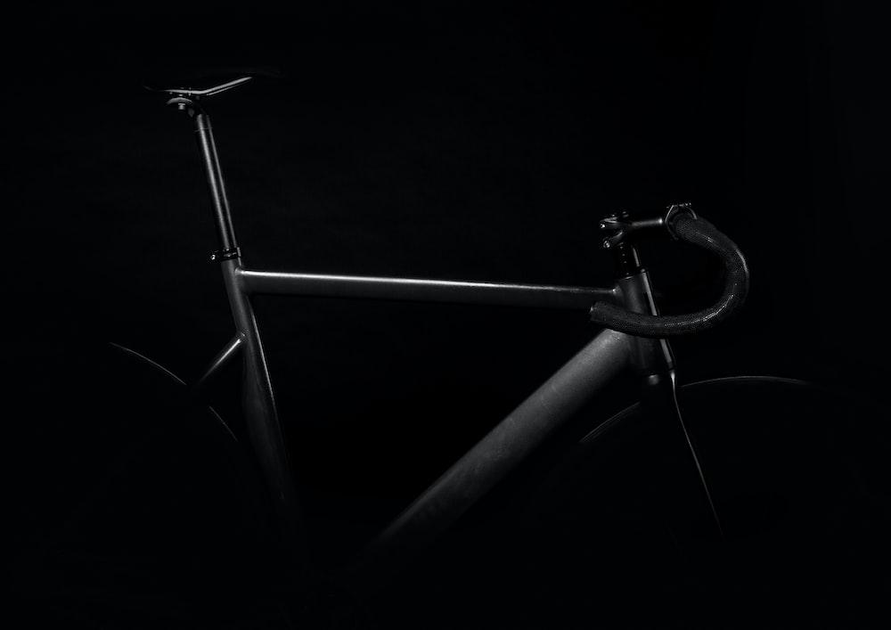 black road bike on against black background