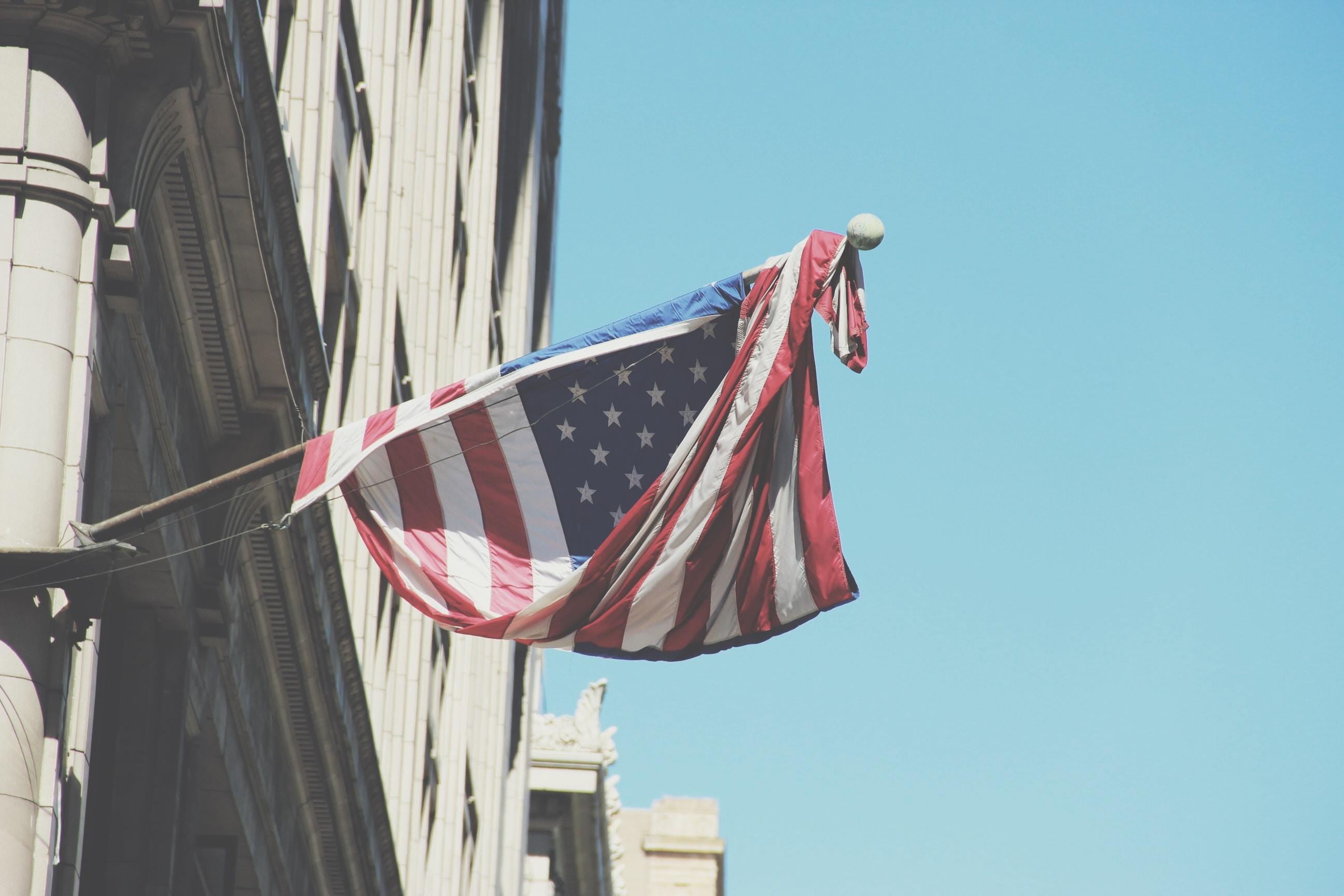 USA flag on building during daytime