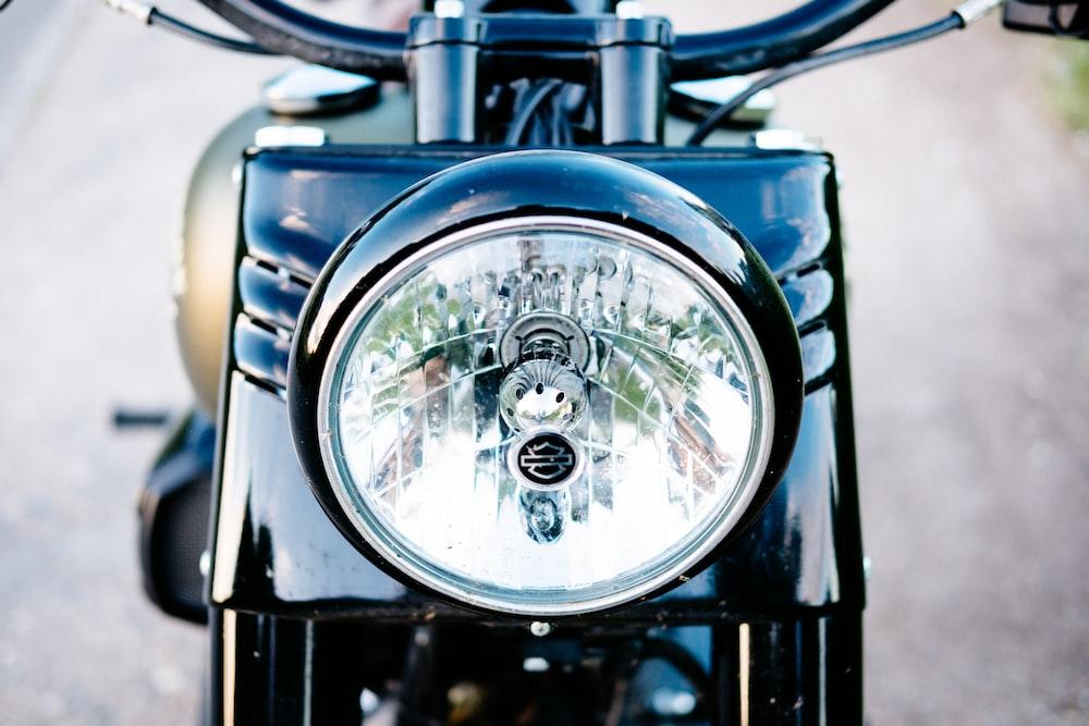 black motor scooter during daytime