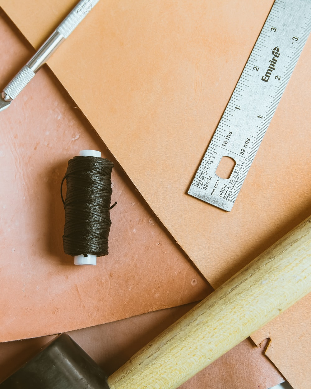 closeup photo of ruler and thread