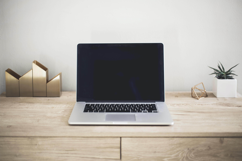 MacBook Pro on top of brown table