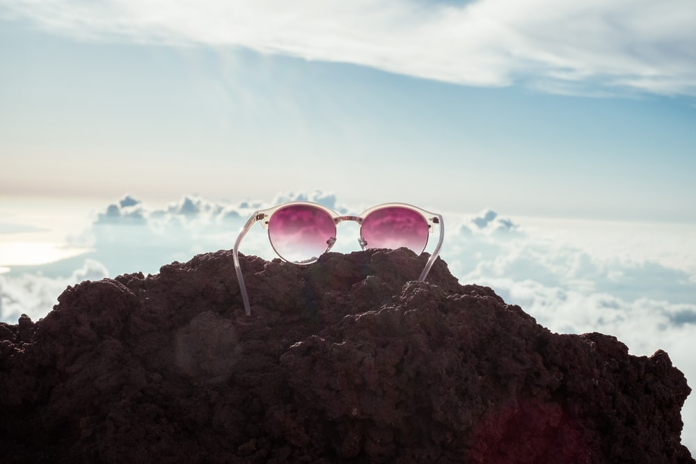 sunglasses on rock