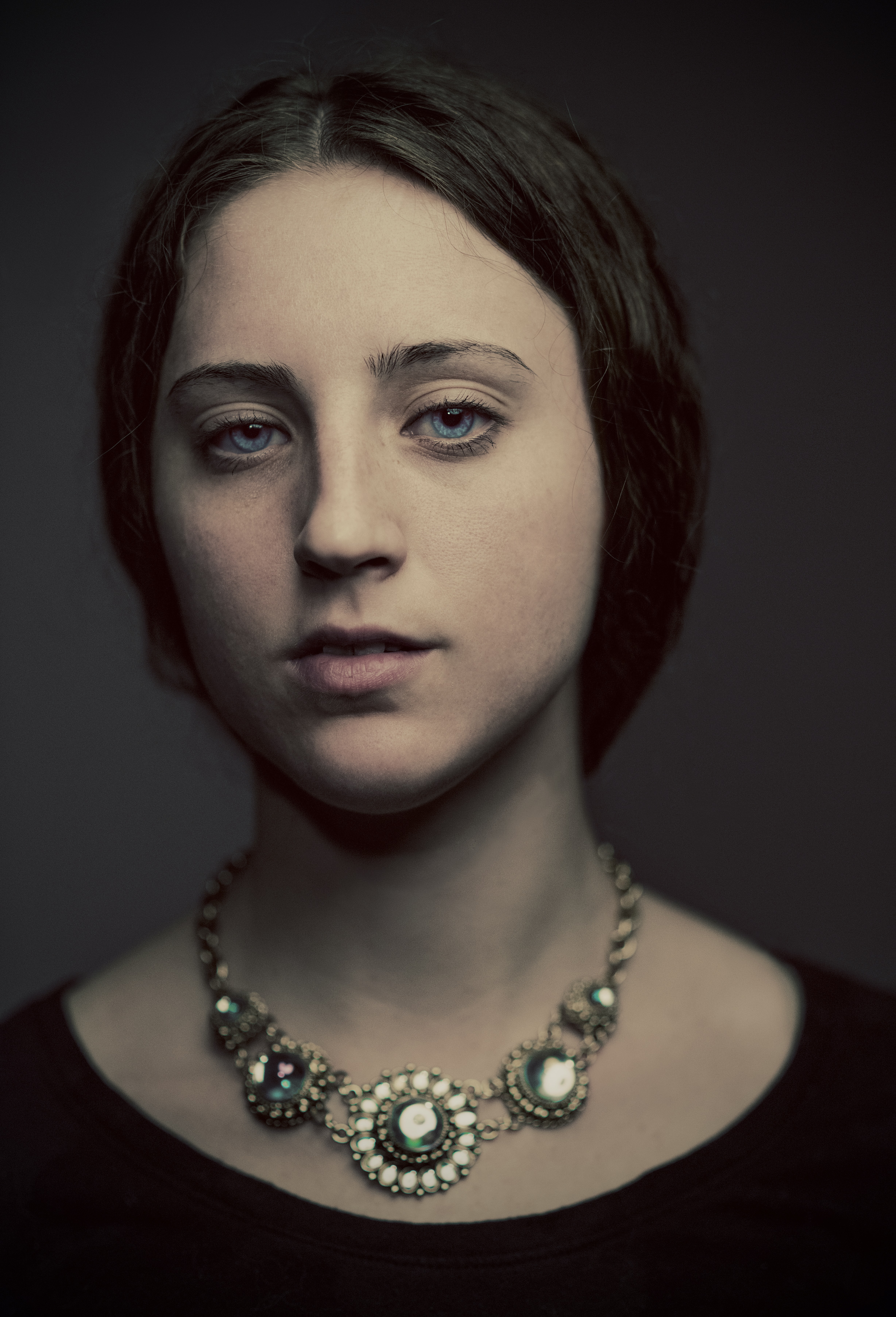 Portrait of a woman in a vintage jeweled necklace