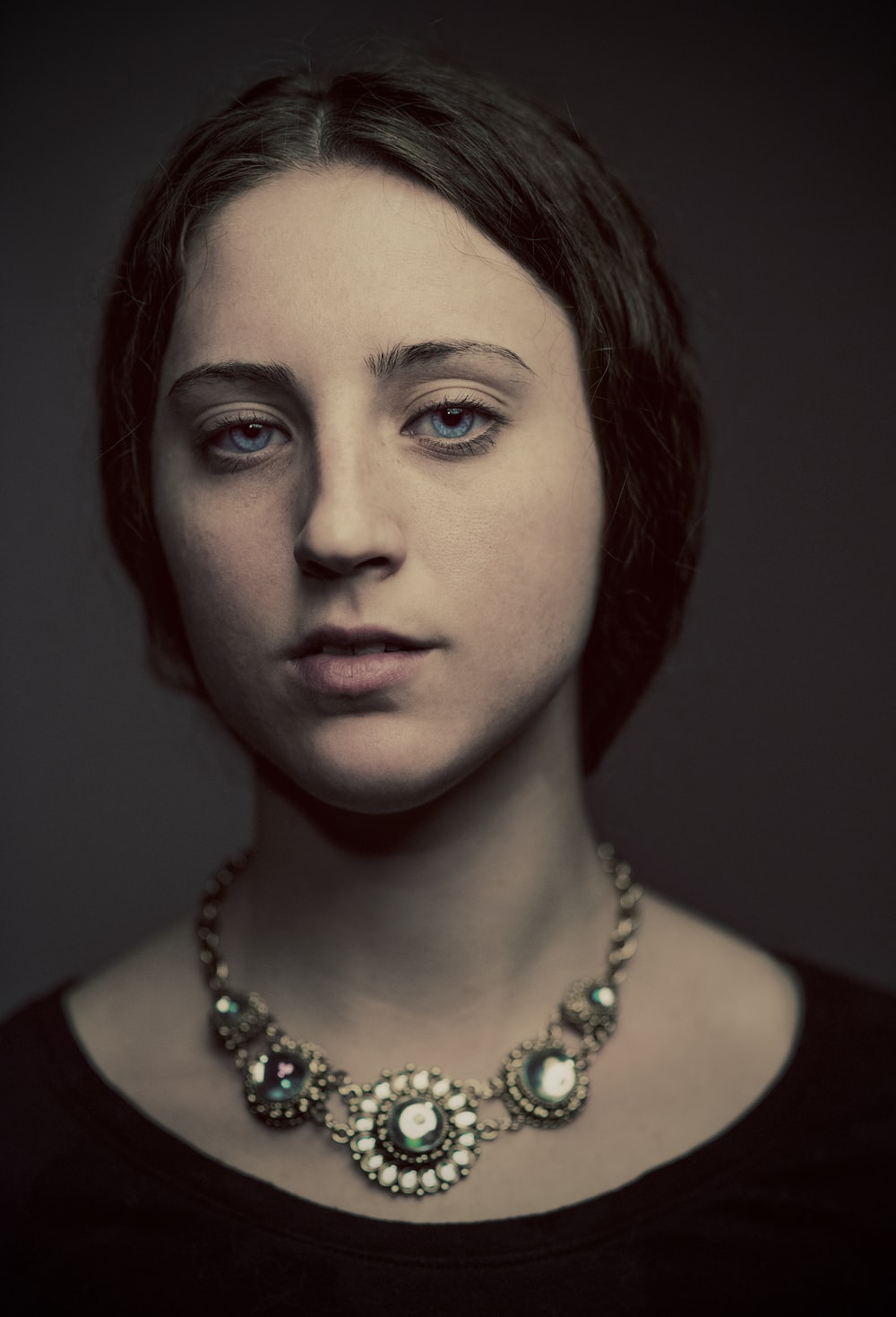 portrait photography of woman in black top