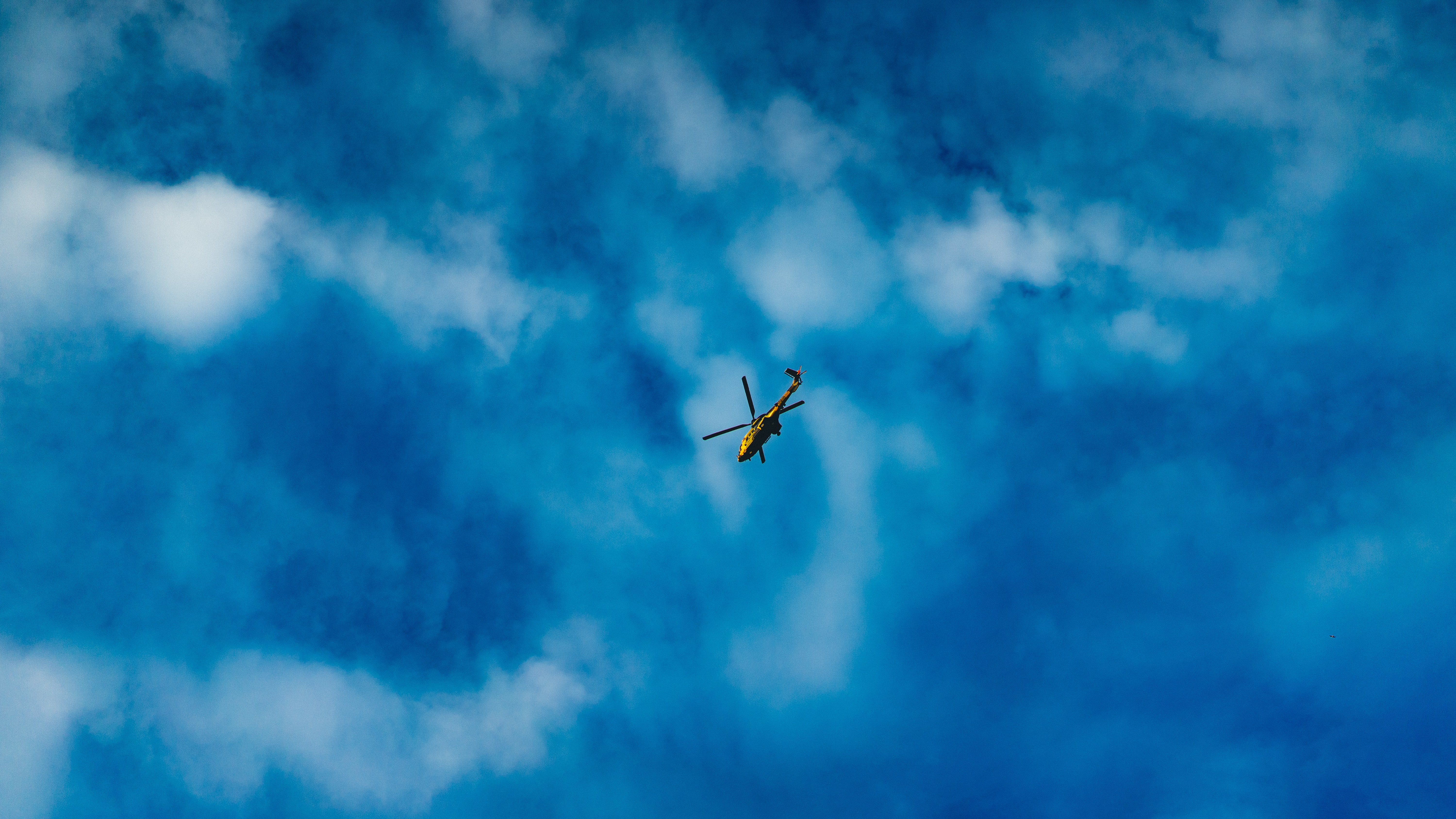green and black helicopter