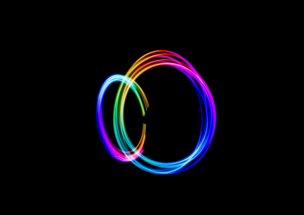 time-lapse photography of person doing circle rainbow light