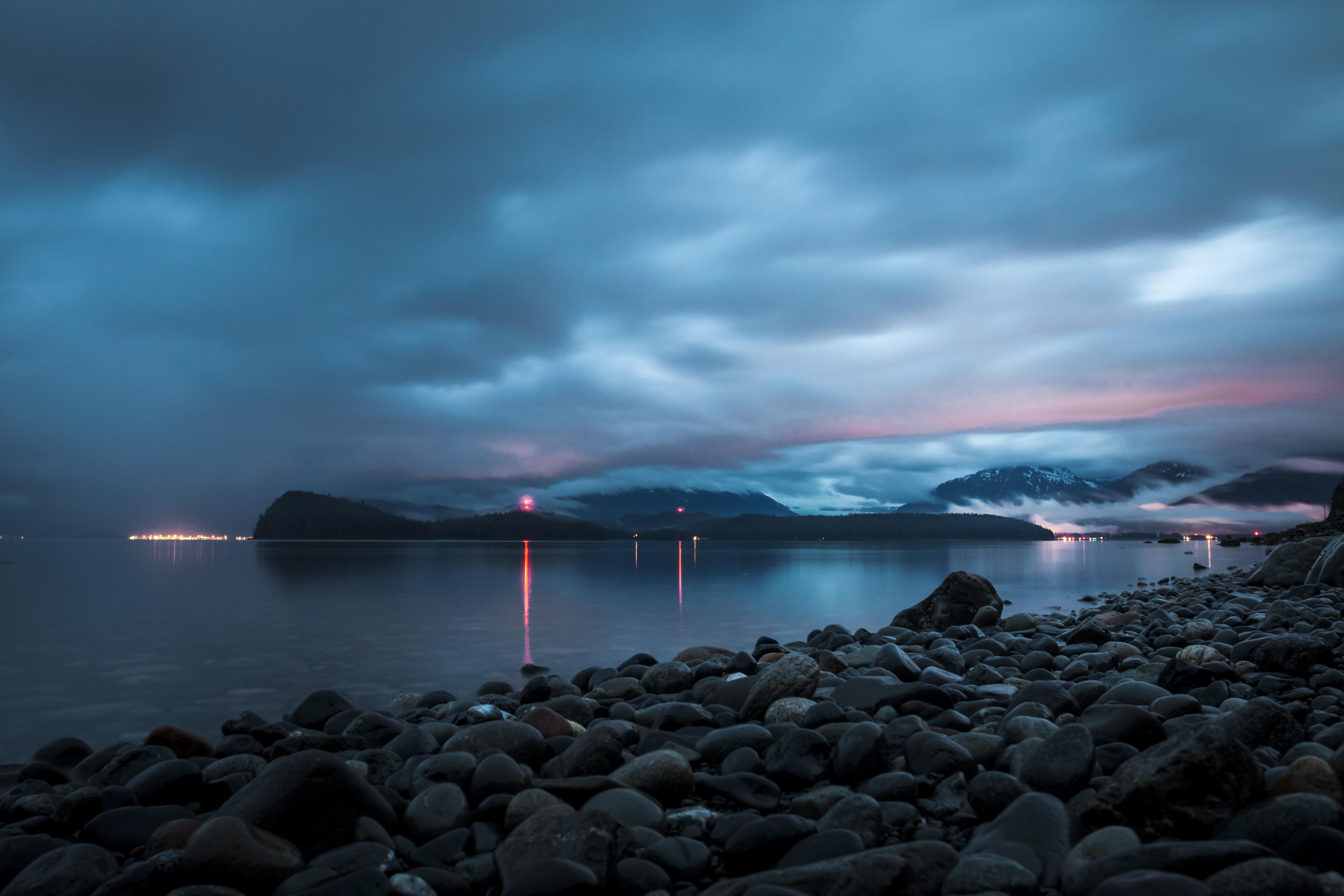 landscape photo of rocks near the body of water
