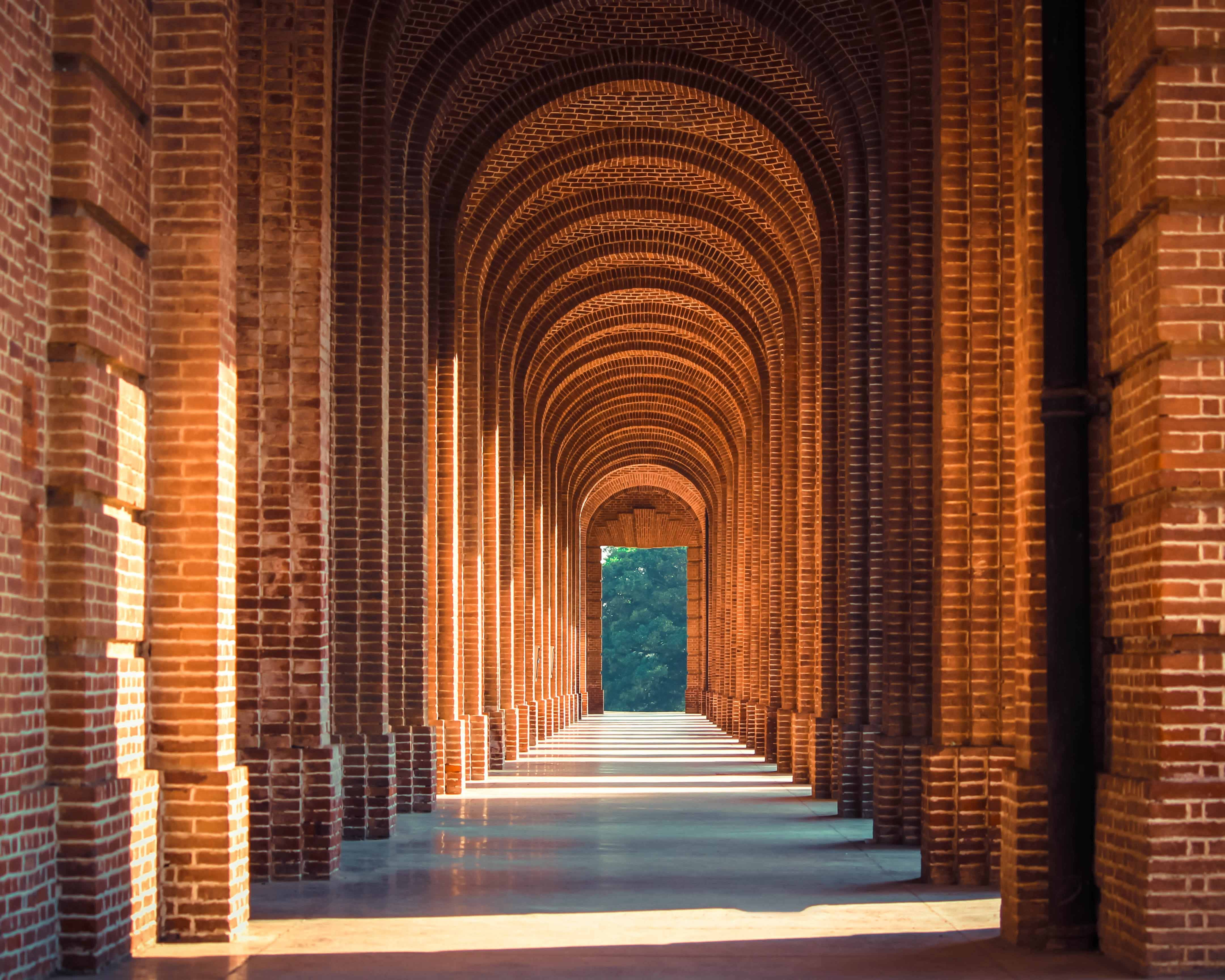 A corridor with a series of brick arches