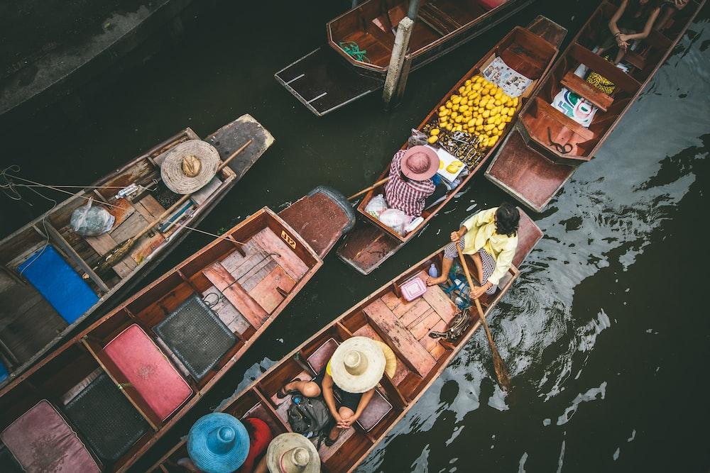 people rowing boat
