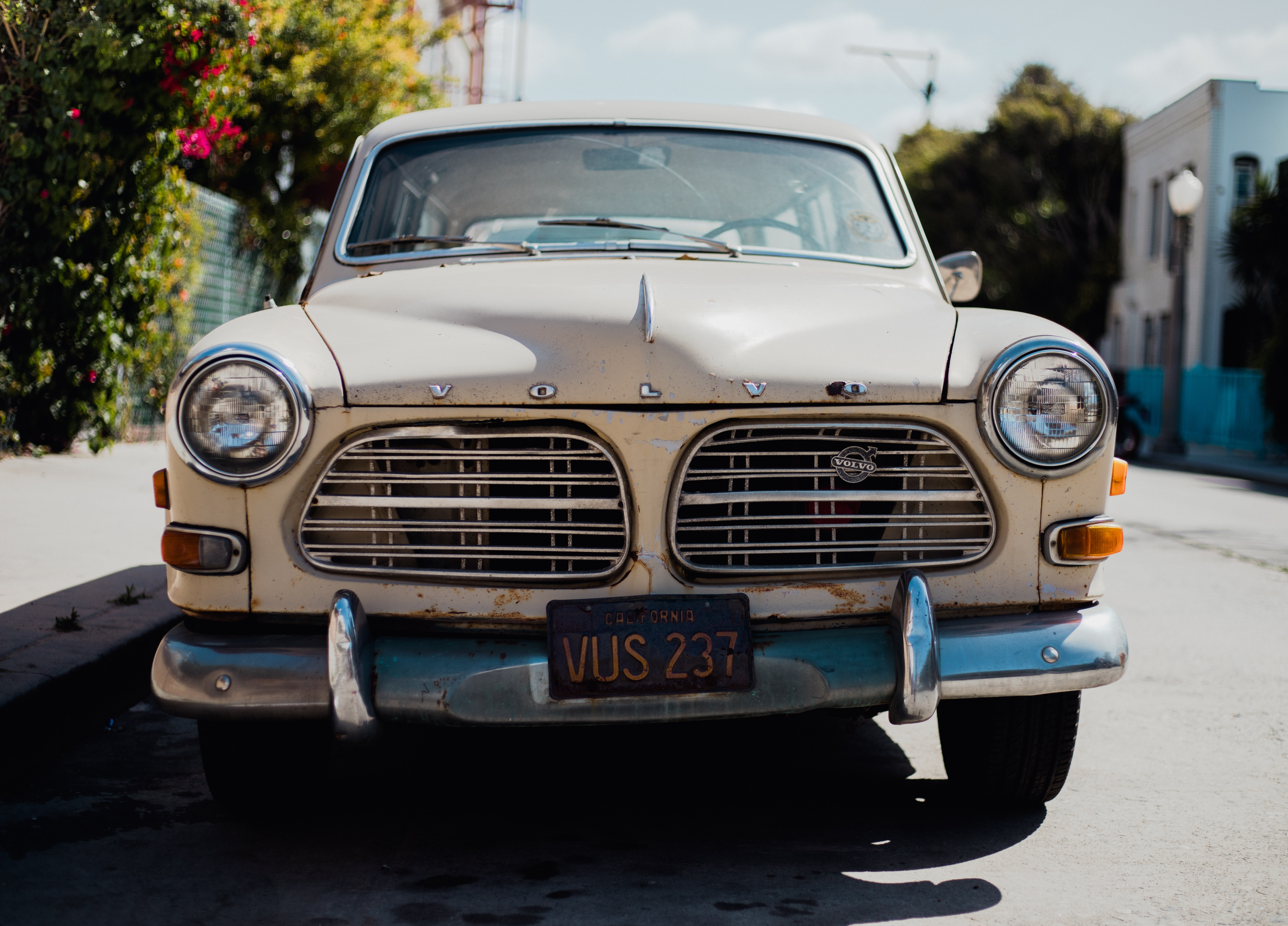 Front view of a white vintage Volvo.