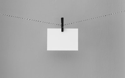 hanged white printing paper note zoom background