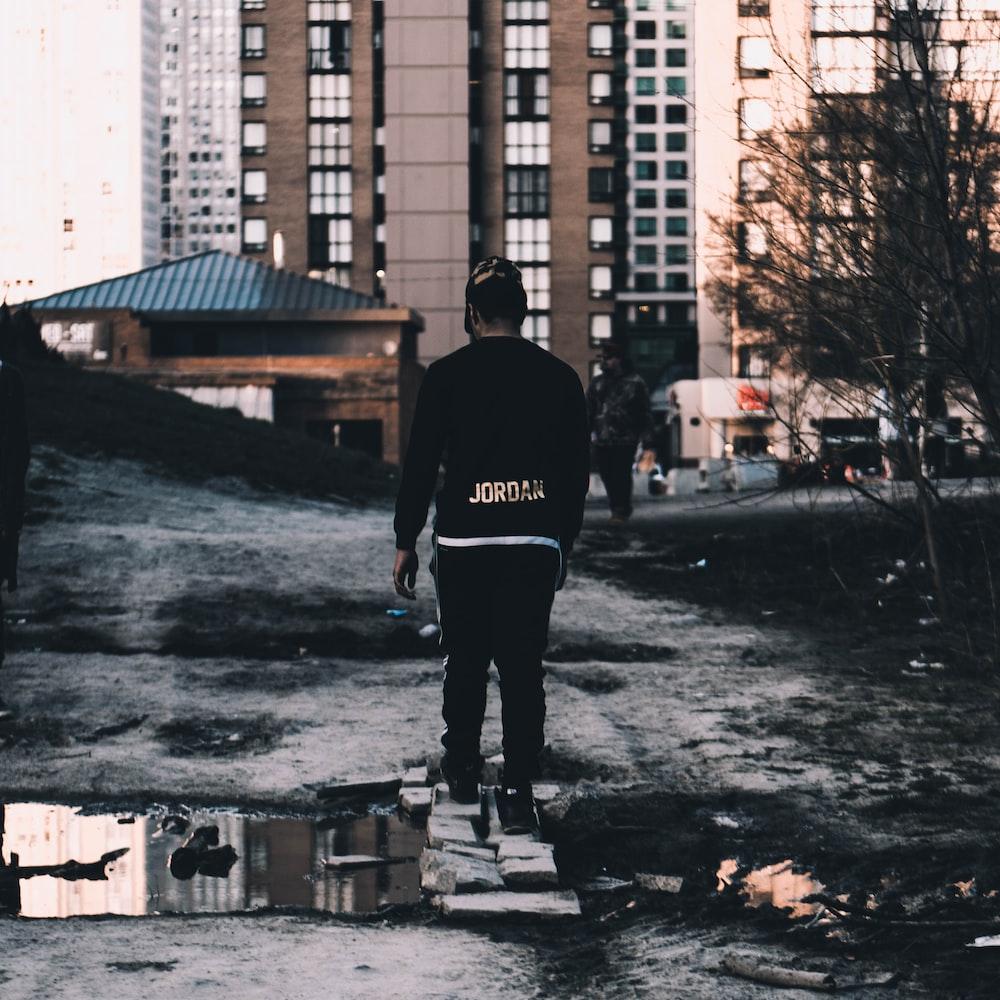person standing on gray bricks