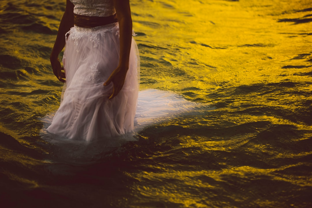 From a wedding i shot in Rarotonga. The bride had purposefully planned to have a 'trash the dress' shoot and the water was sooooo warm! Shot after sunset when the sky glow was still bright enough. Love the mustard tones on the water too.