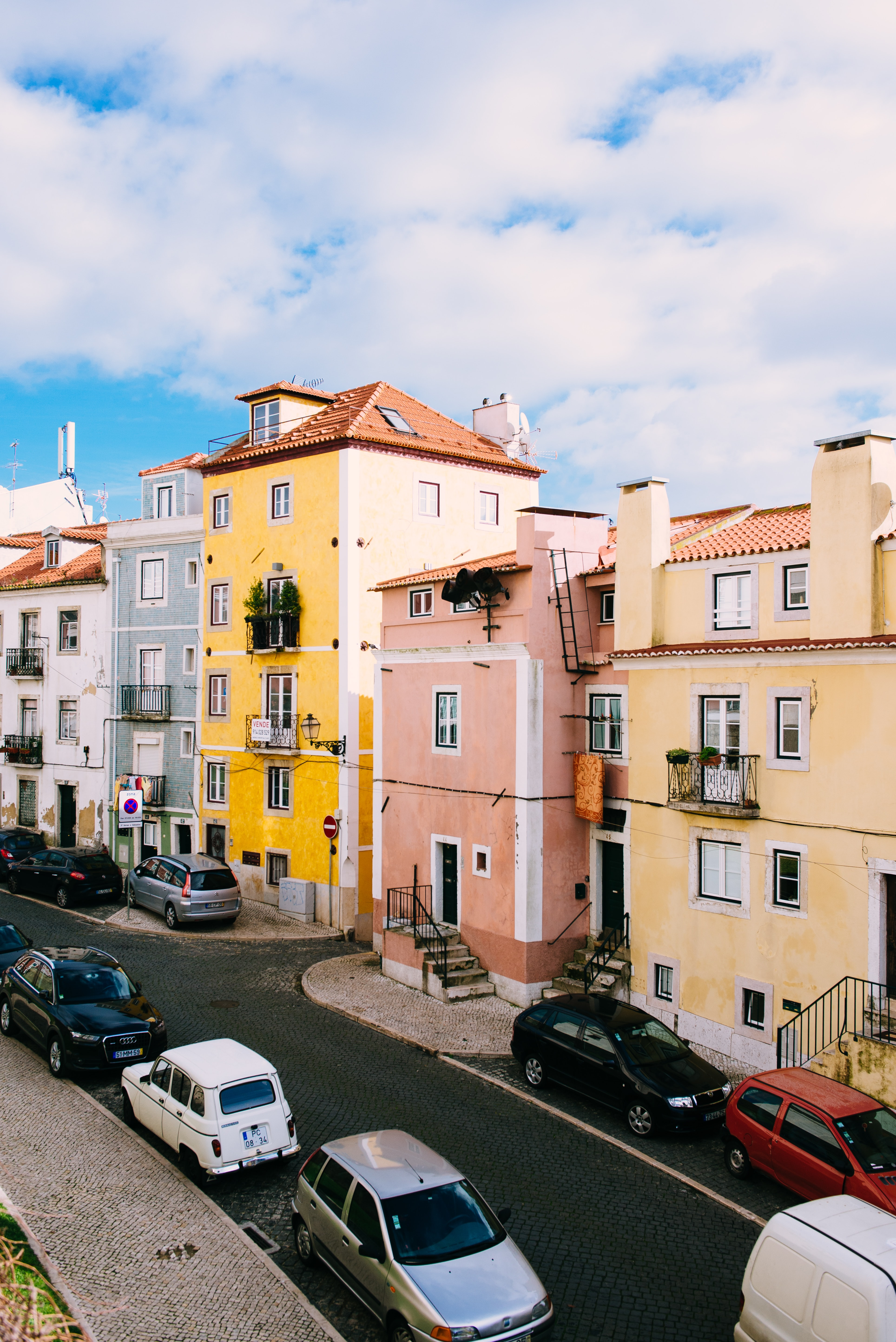 Street with small residential buildings with colorful facades in Lisbon