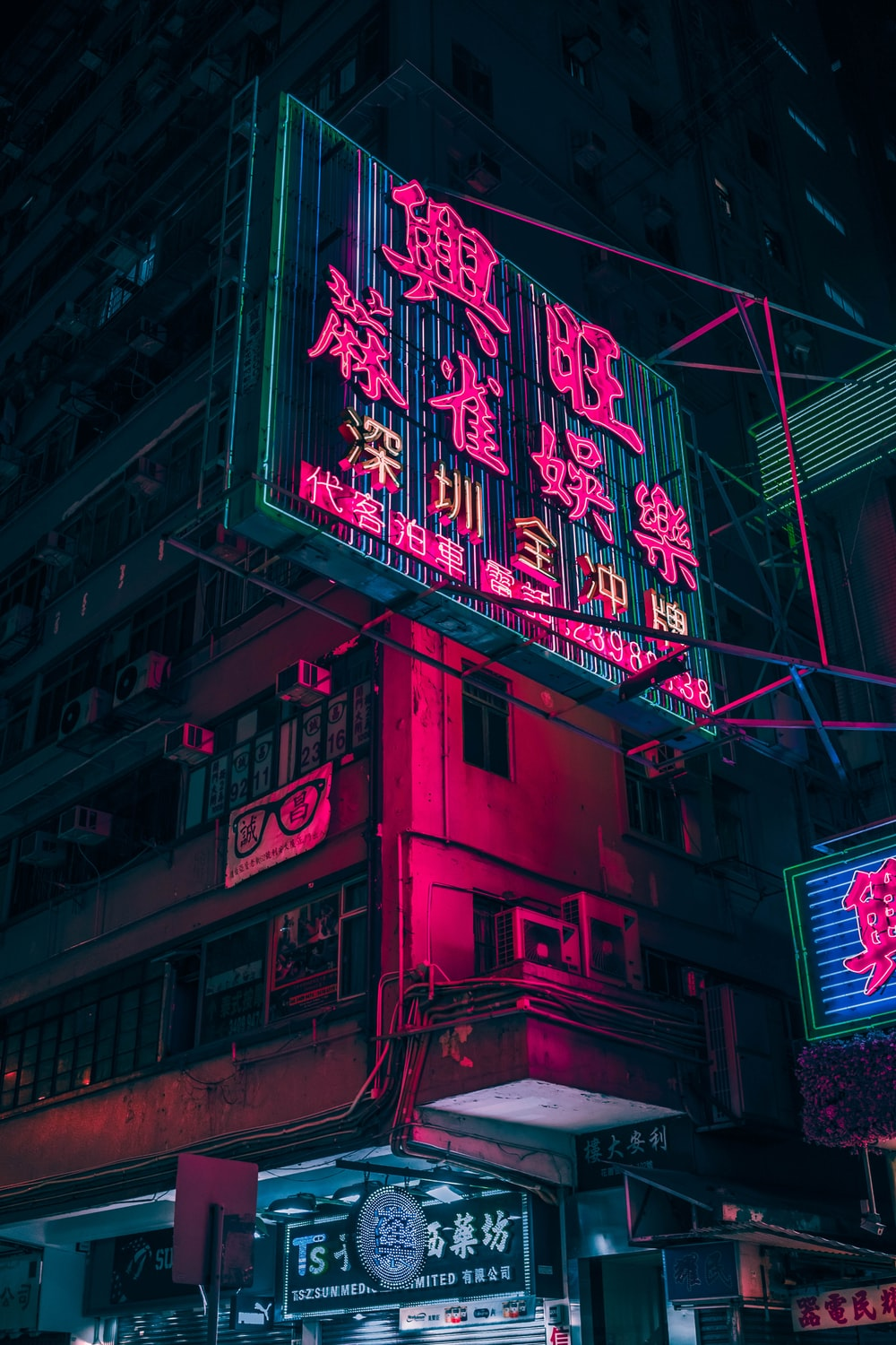 closeup photo of red and black lighted signage