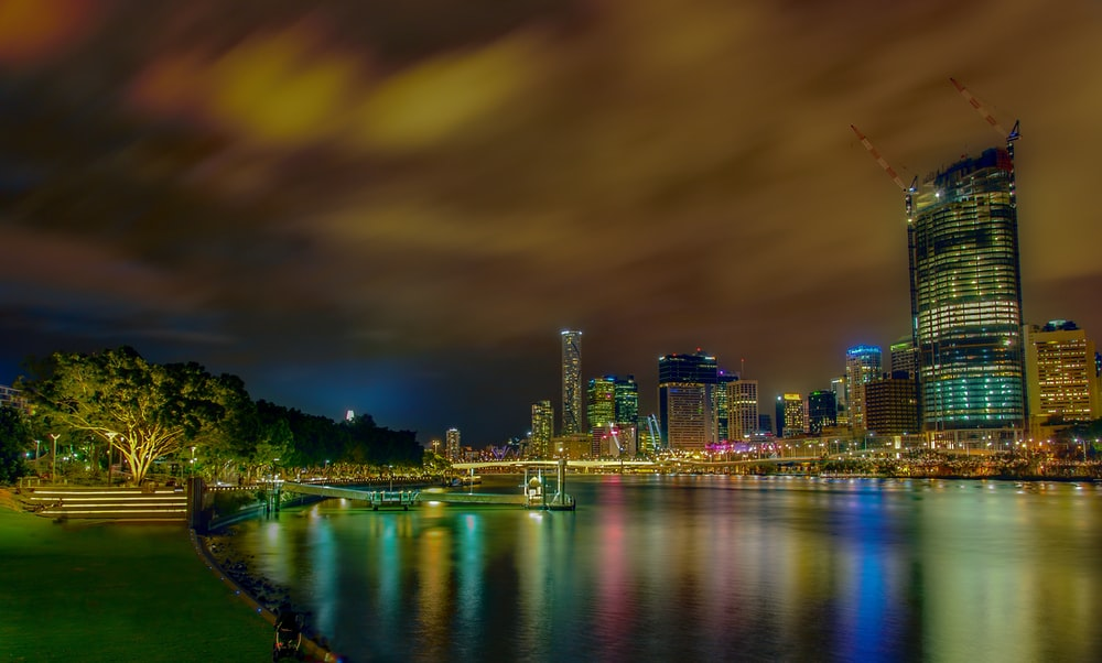 city lights reflecting on body of water