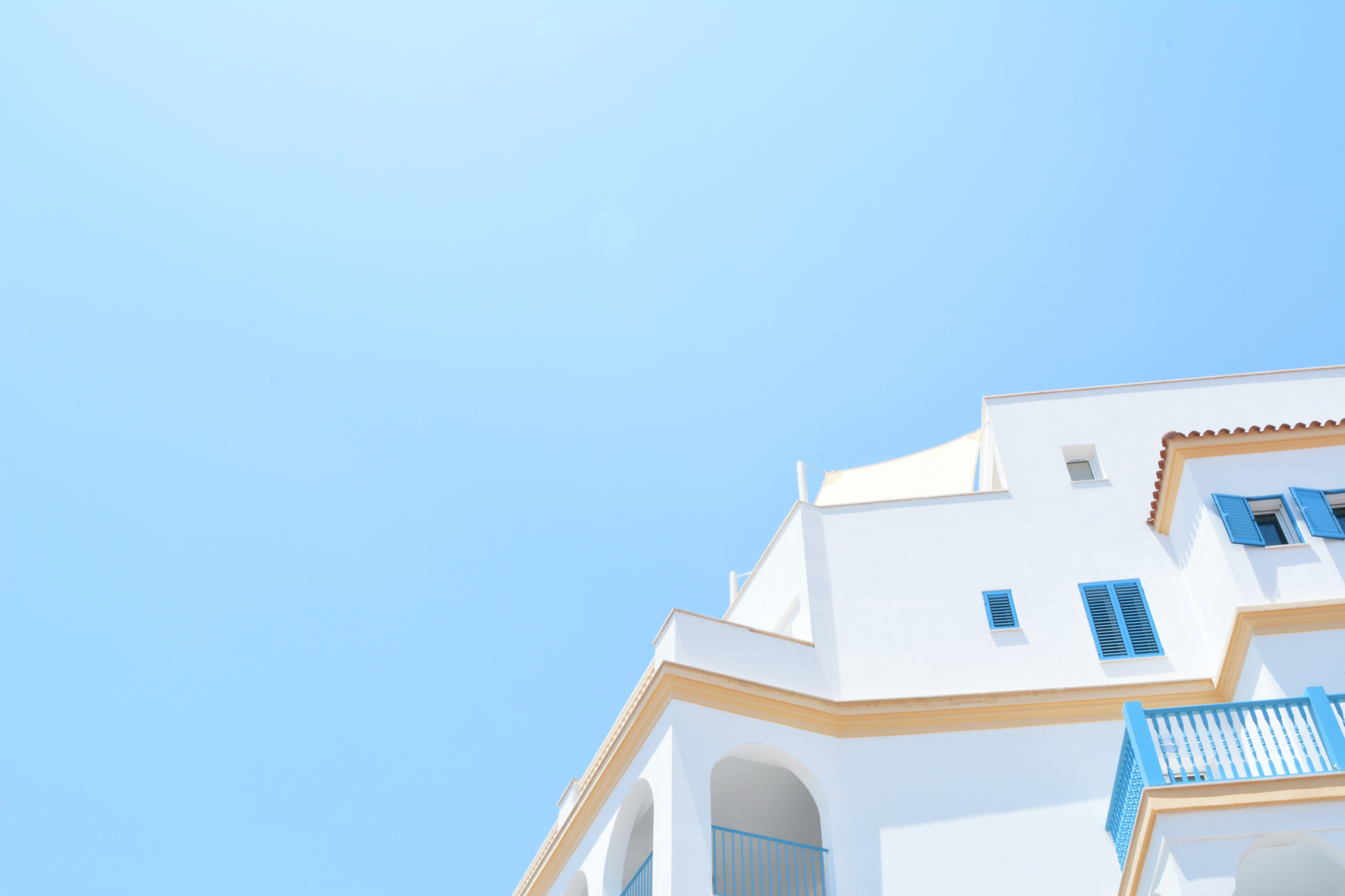 A white Mediterranean-style building under a blue sky