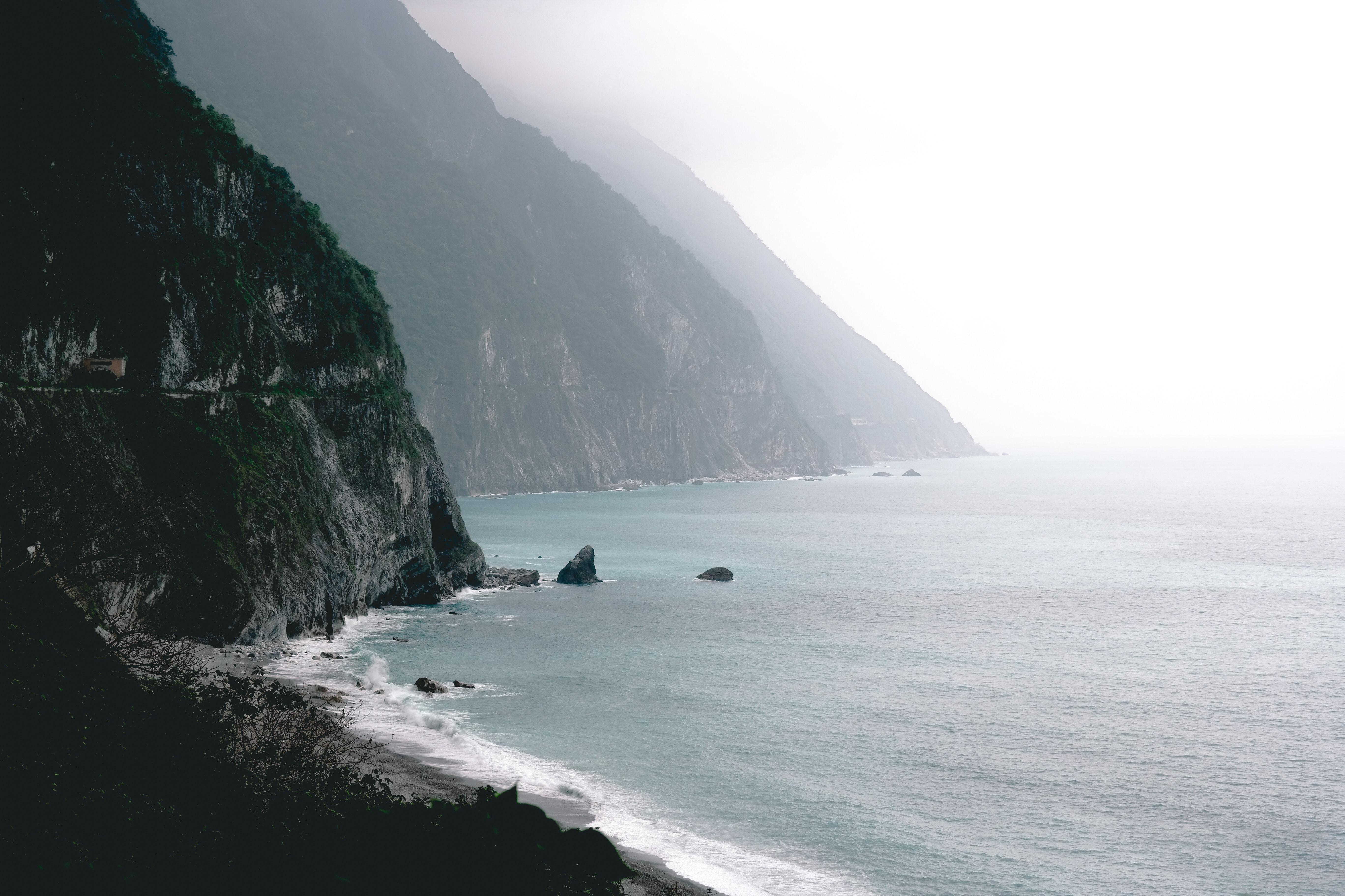 landscape of seashore near mountain
