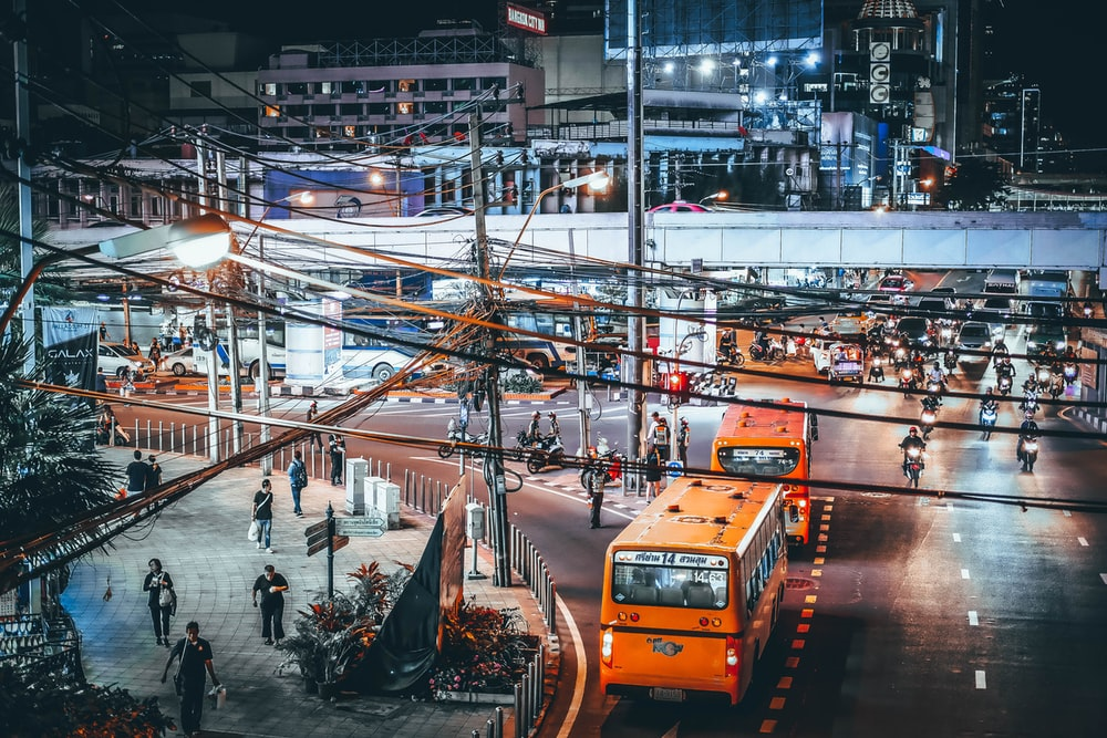 two yellow bus beside street during night time