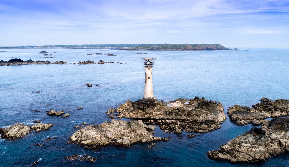 watch tower on island under blue skies