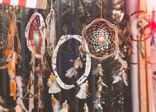 closeup photo of hanging dream catchers