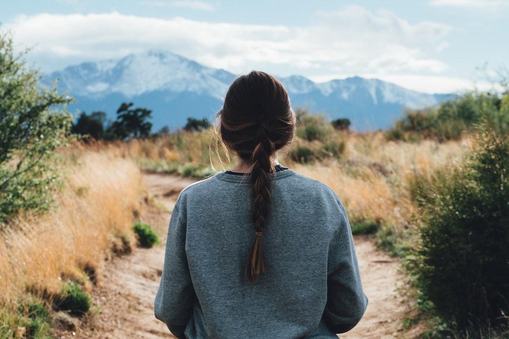 woman walking along pathway during daytime