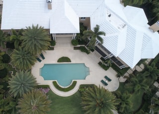 aerial view photography of white house near swimming pool