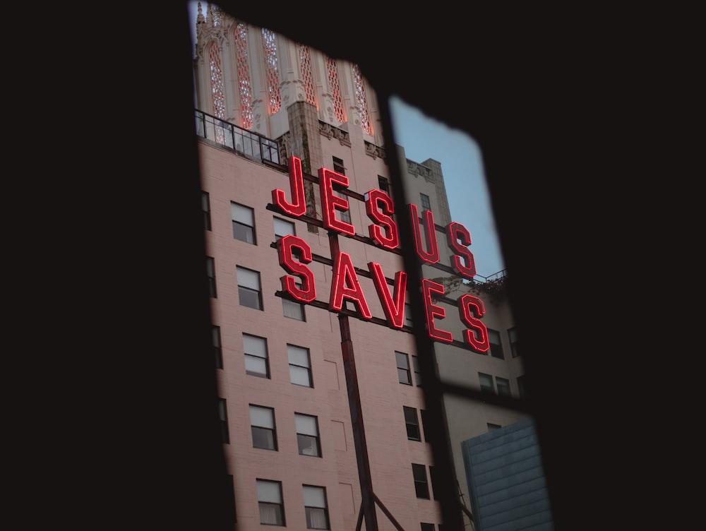 Jesus Saves LED signage on concrete building