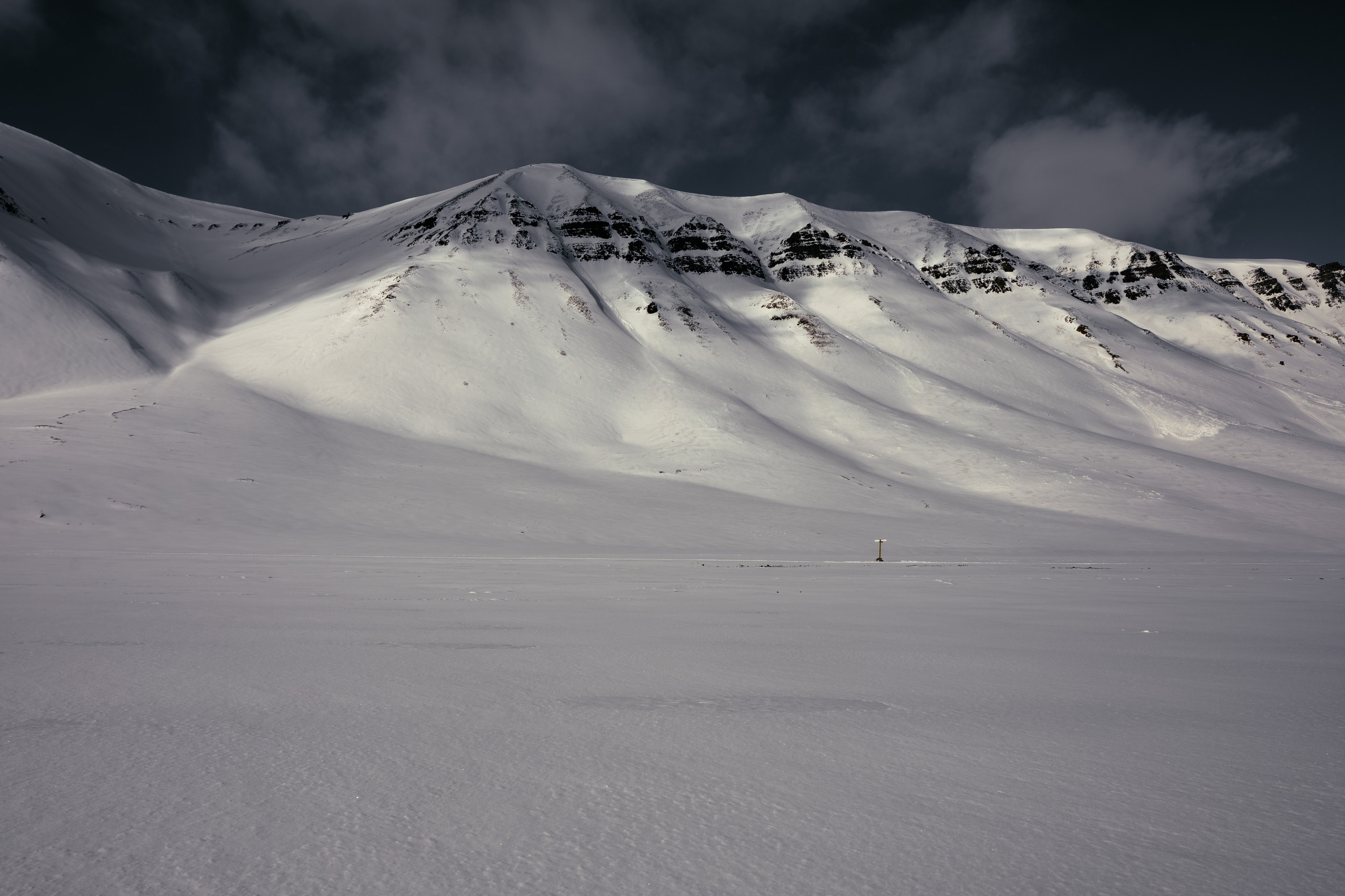 Tall hills in an Arctic wasteland near Longyearbyen