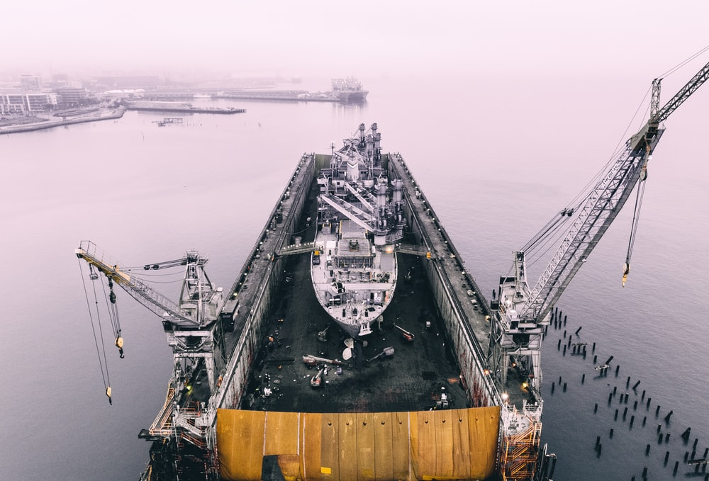 photo of ship on inside oil rig