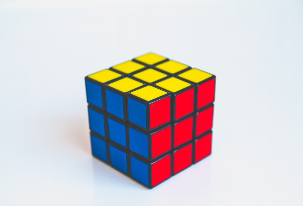 yellow, blue, and red 3x3 puzzle cube toy