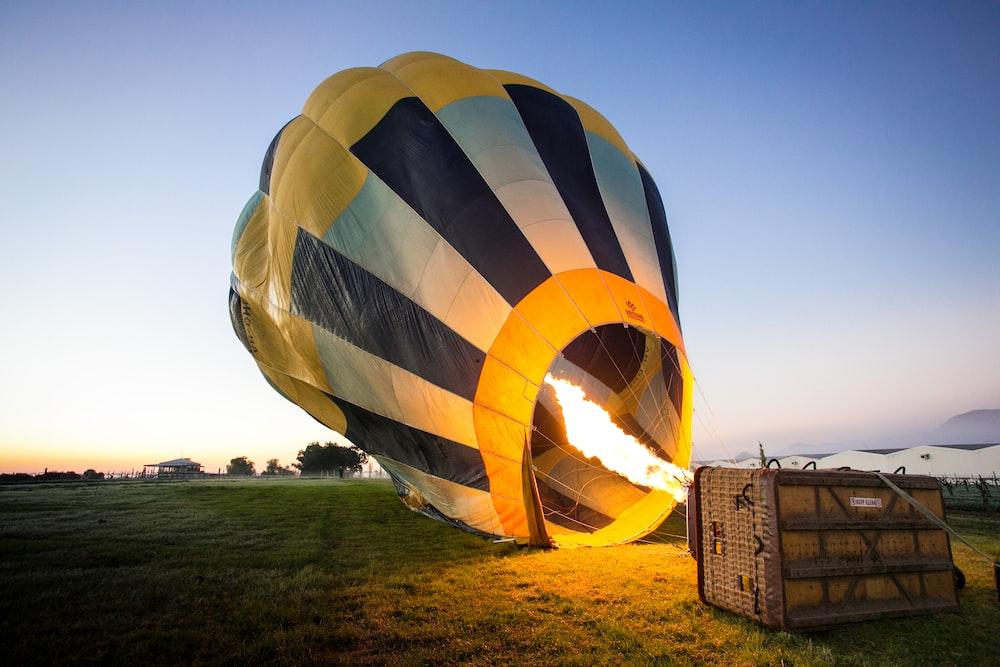 yellow and blue hot air balloon at daytime