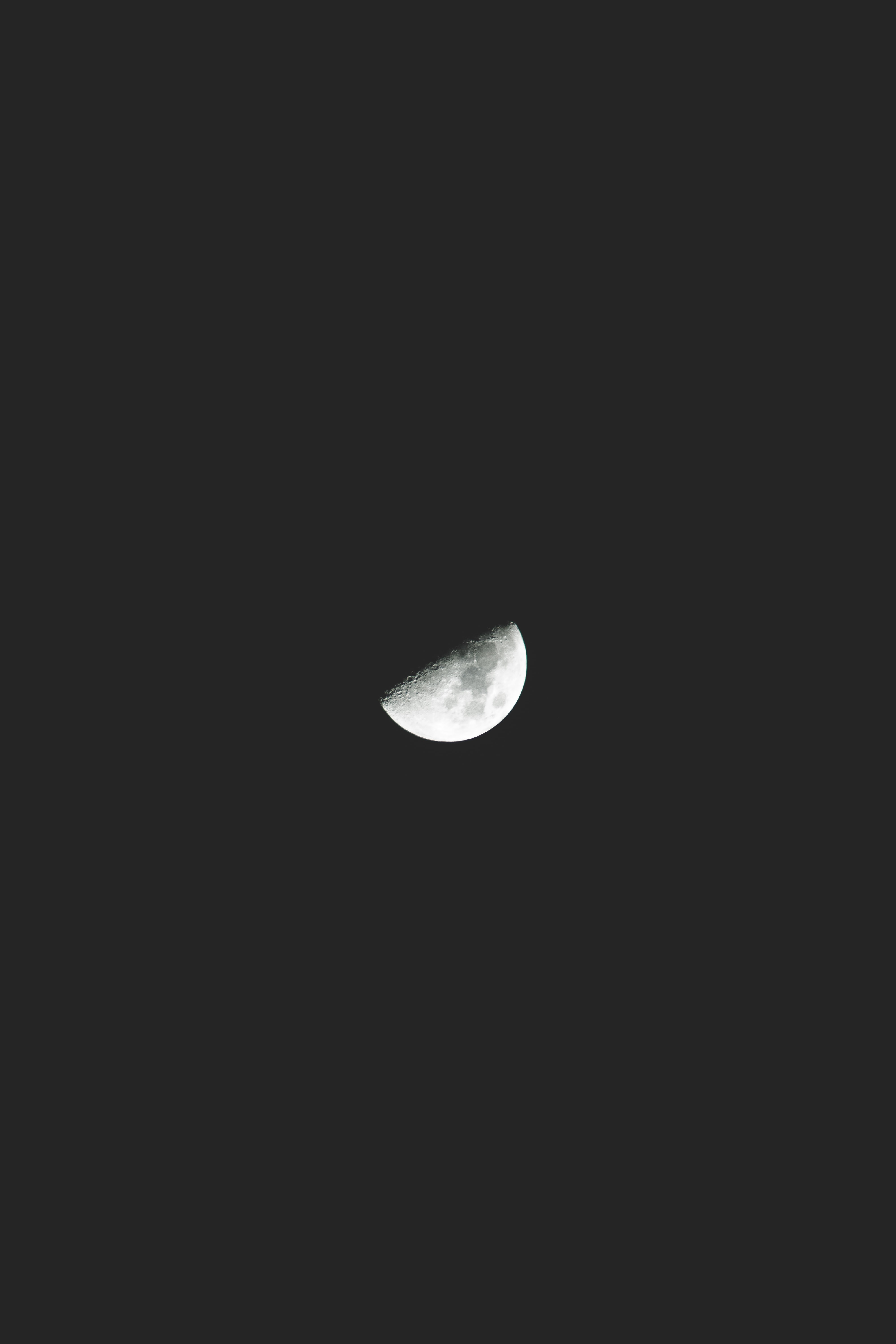 A half moon on the night sky