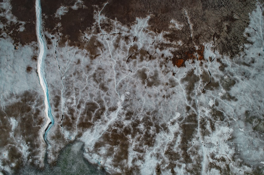 aerial photography of land near river at daytime