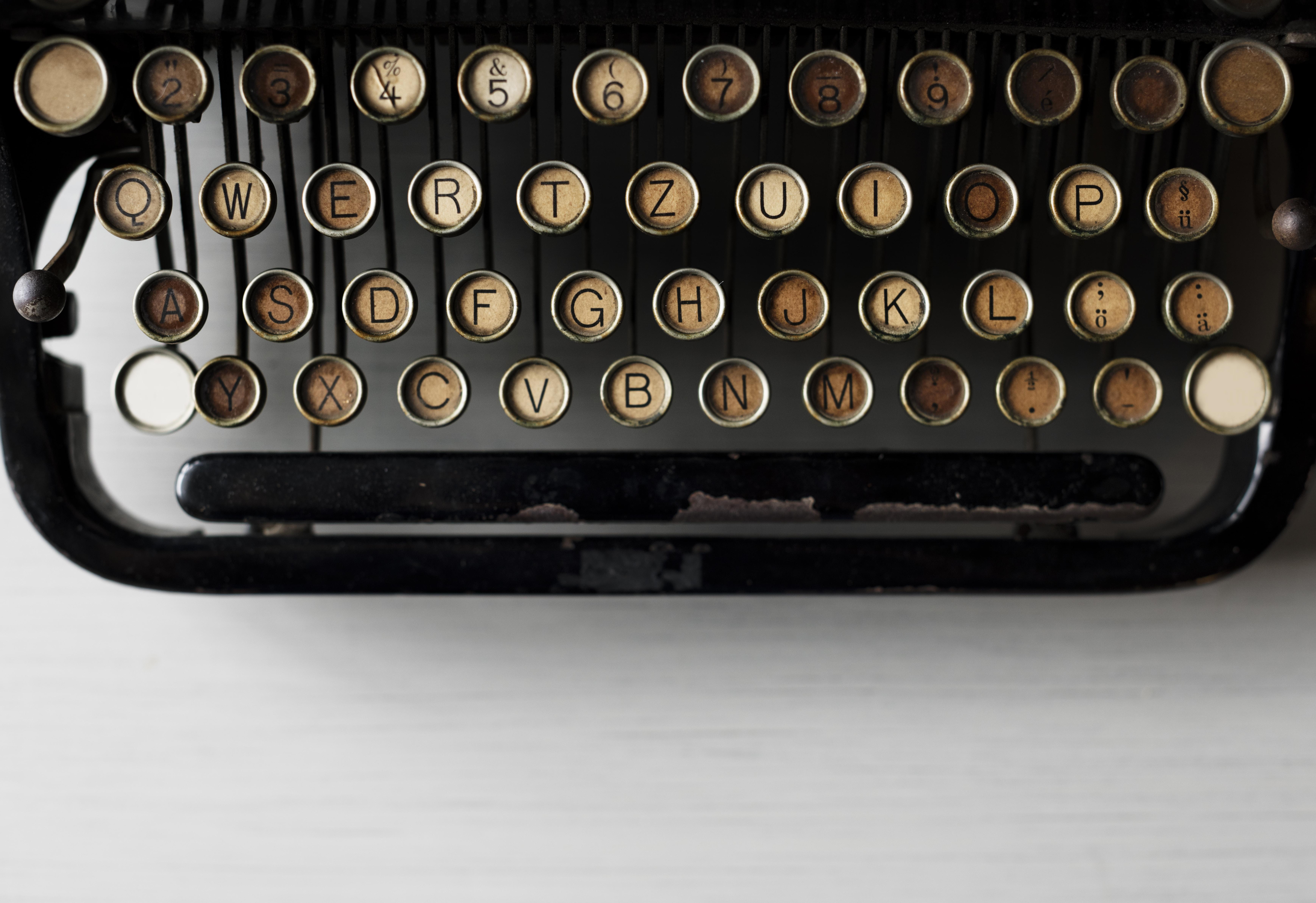 closeup photo of vintage black typewriter