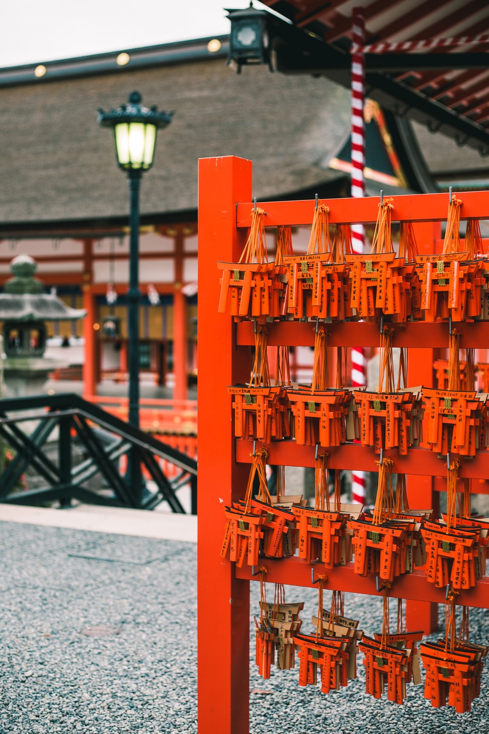 shallow focus photography of wooden chimes