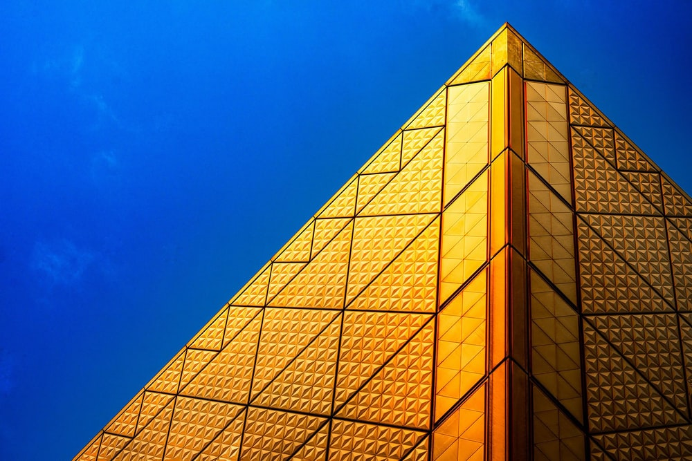 pyramid structure under blue sky