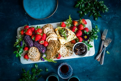 """Slid my cart over for checkout, the attendant peeked inside and said """"having a party, eh?"""" Indeed. Wine, cheese, crackers and berries. What more could a party ask for?"""